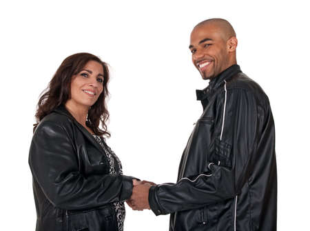 Multicultural couple holding hands and smiling. Mature woman with younger man. photo