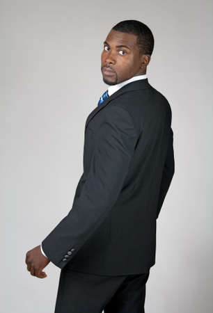 döndürme: African American businessman turning and looking back.