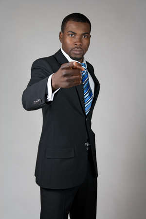 African American businessman pointing finger at you. photo