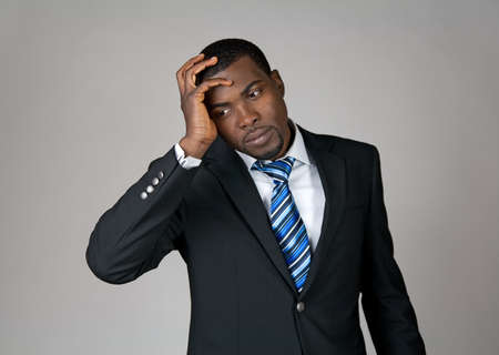 grieving: Business going wrong. African American businessman looking frustrated. Stock Photo
