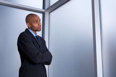 looking for a job: Businessman looking through the window with a worried expression.