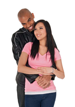 Young loving couple smiling - African American guy with Asian girlfriend.