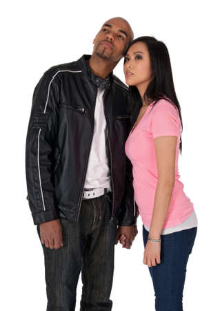 two visions: Young couple looking in one direction - African American guy with Asian girlfriend. Stock Photo