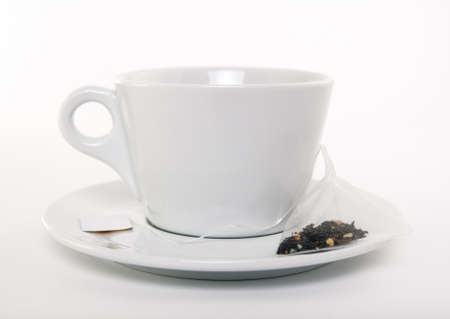White cup of tea and teabag, on white background.