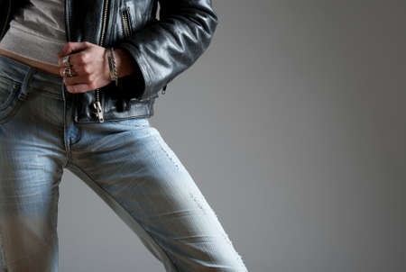 to tight: Young woman wearing jeans and black leather jacket.