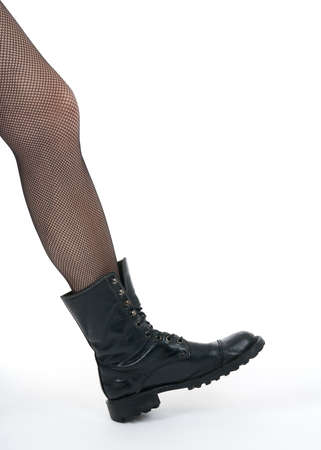 army girl: Female leg in black army boot stepping into the picture. Stock Photo