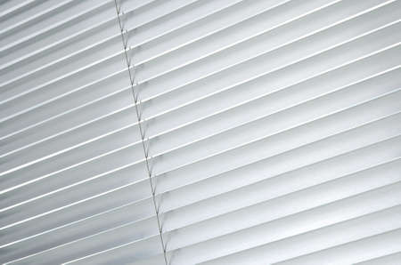 venetian blind: Window with closed metallic blinds, view from inside