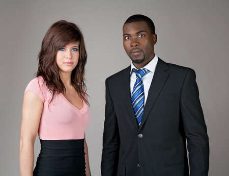 african business: Portrait of young business partners, Caucasian woman and African American man