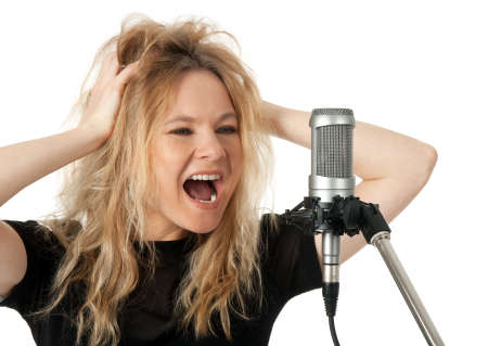 live action: Female rock singer screaming to the microphone  Isolated on white background  Stock Photo