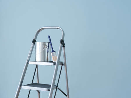paint tin: Preparing to paint the wall  Painting tools on a metal ladder