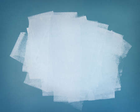 Brushstrokes of white paint covering the blue wall  Abstract background  photo