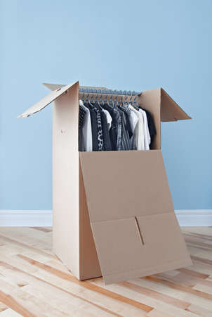 parquetry: Wardrobe box with black and white clothing, prepared for transportation  Stock Photo