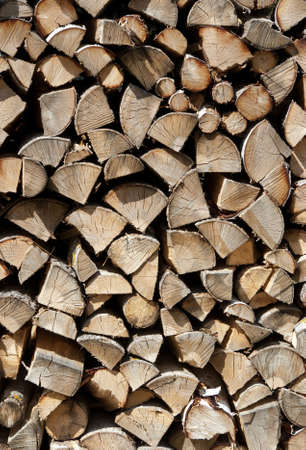 Chopped wood stacked in a big pile  Abstract background  photo
