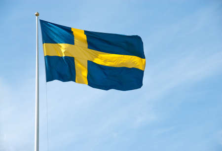 sweden flag: Swedish flag waving in the blue sky on a sunny day