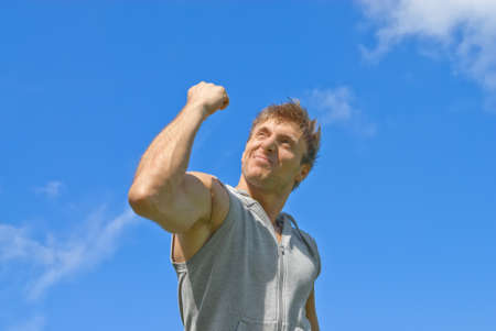 Sporty young man showing his strength  Outdoor training  photo
