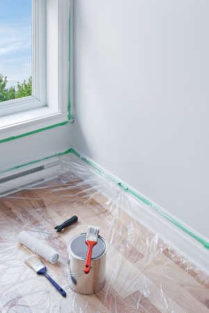 Renovations  Painting tools and floor protected by plastic  photo