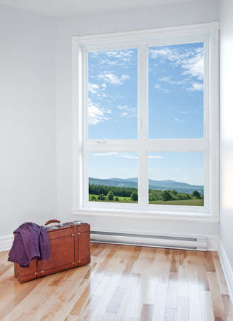 Just arrived  Retro suitcase in an empty room with beautiful view