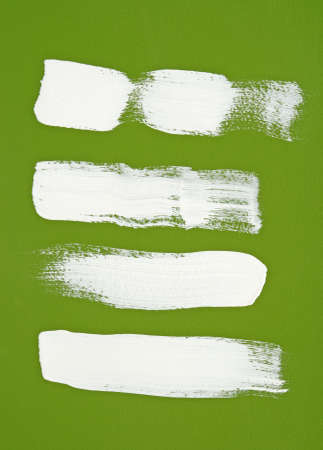 White brush strokes on bright green background  photo