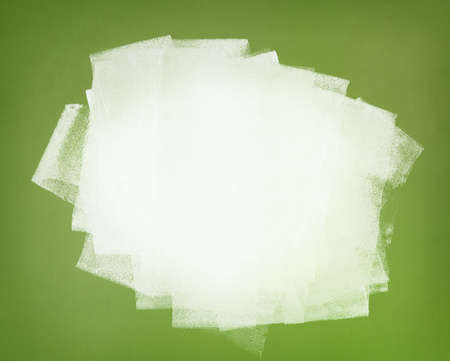 Brushstrokes of white paint covering the green wall  Abstract background  photo