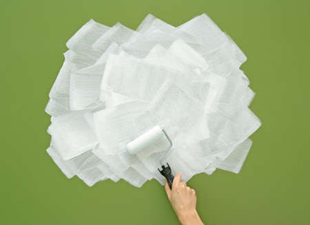 Painting green wall in white color with paint roller  Acrylic paint texture  photo