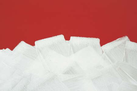 Bright red wall painted in white with paint roller  Brush strokes texture  photo