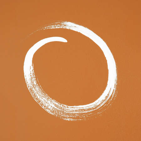 White circle painted on orange background  Brush stroke texture  photo