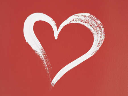 White heart painted on red background  Brush stroke texture  photo