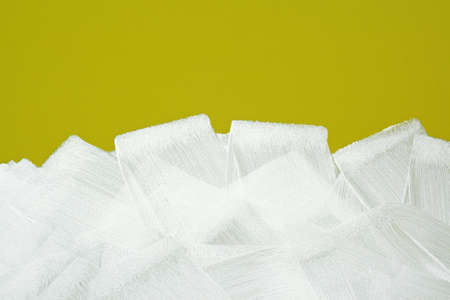 Bright yellow wall painted in white with paint roller  Acrylic paint texture  photo
