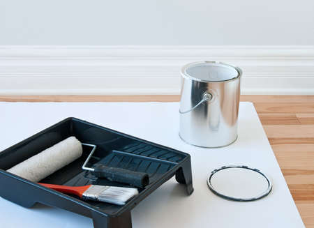 Renovations  Painting tools and an open can of paint Stock Photo - 16431190