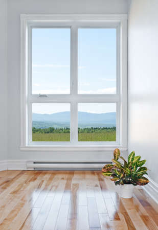Empty room with beautiful view over field and mountains