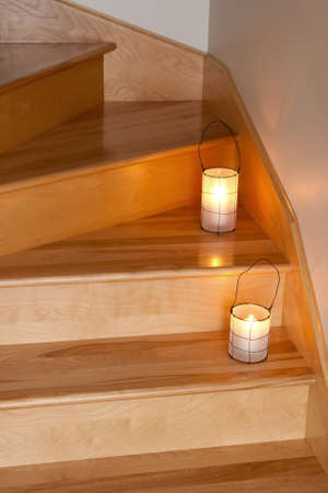 candle holder: Cozy lanterns with candles decorating wooden staircase