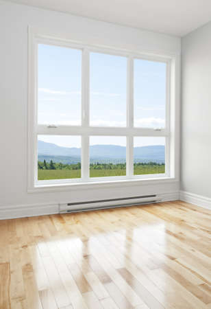living room window: Summer landscape seen through the big window of an empty room  Stock Photo