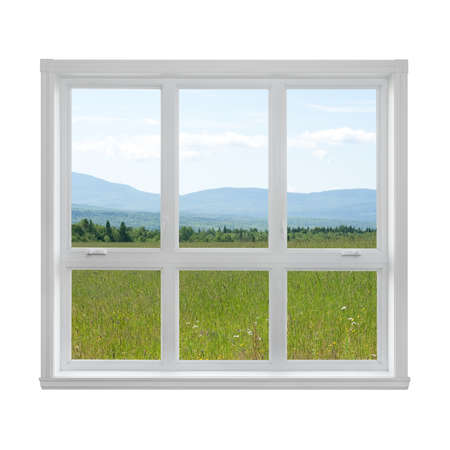 Summer field and mountains seen through the window  photo