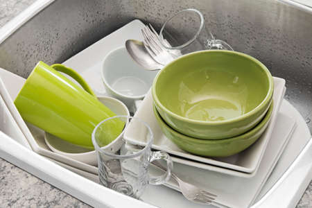 Dishwashing  Bright dishes in the kitchen sink Stock Photo - 16674108