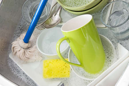 Washing bright dishes in the kitchen sink  photo