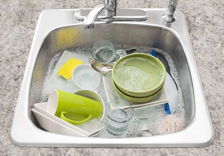 bowl sink: Dishwashing  Bright dishes soaking in the kitchen sink