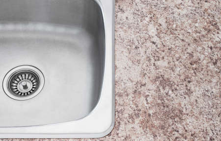 sink drain: New shiny kitchen sink and countertop detail