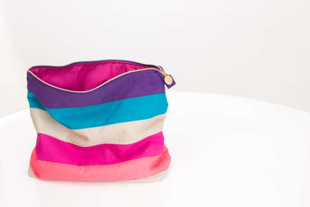fabric bag: Bright cosmetic bag with colorful stripes, on white background