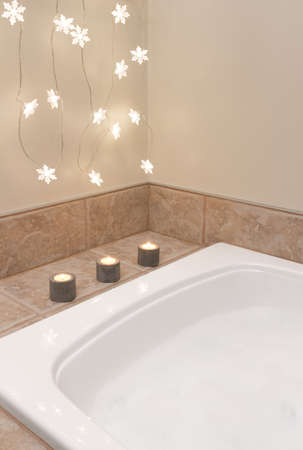 chandler: Bath with foam  Bathroom decorated with cozy lights and candles