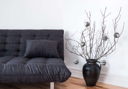 Gray sofa and simple winter decorations in the living room. photo