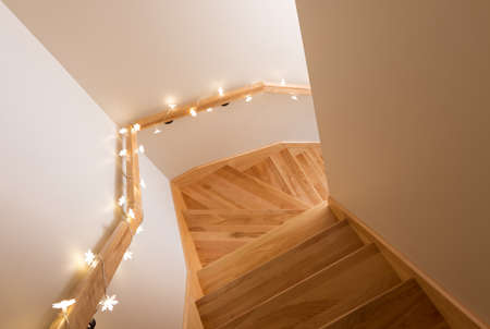 Cozy lights decorating wooden staircase. Home interior. photo