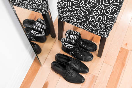 Black leather shoes on a wooden floor, reflecting in the mirror. Stock Photo - 17677406