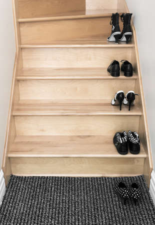 wooden shoes: Black and white shoes on a wooden staircase.