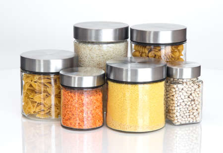 Food storage  Food ingredients in glass jars, on white background