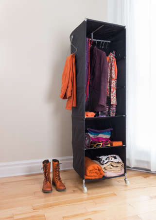 clothes organizer: Mobile wardrobe in a room  Clothing organization