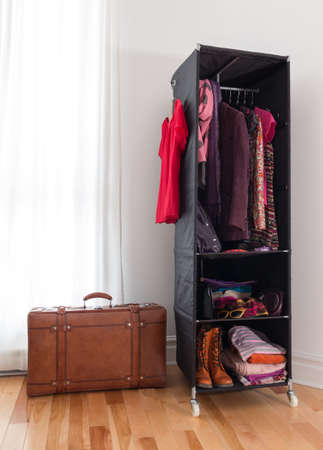 casters: Leather suitcase and mobile wardrobe with clothing, shoes and accessories