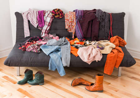 What to wear  Messy colorful clothing on a sofa