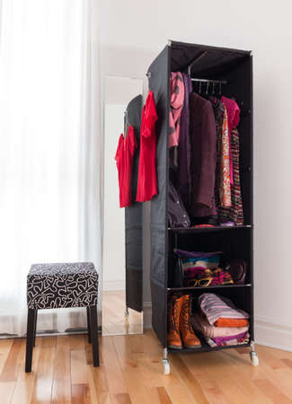 clothes organizer: Mobile wardrobe with bright clothing, shoes and accessories
