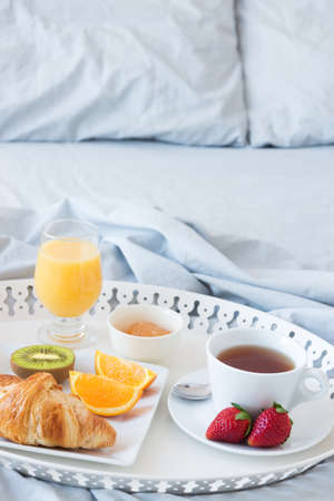 Breakfast in bed  Tray with fresh and tasty morning meal  photo