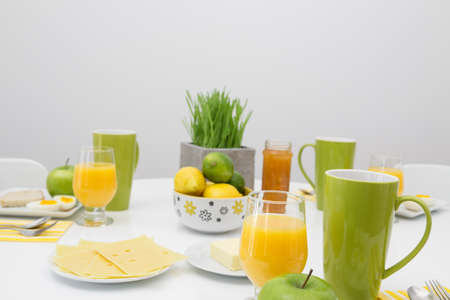 Bright table setting with fresh tasty breakfast  photo